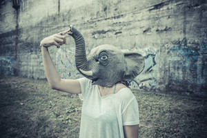 elephant mask halloween young beautiful moroccan curly woman at the park