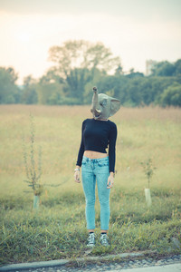 elephant mask young beautiful brunette straight hair woman outdoor