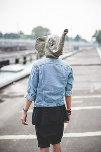 elephant mask young handsome bearded hipster man in the city