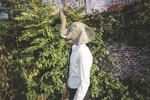 elephant mask young handsome elegant blonde model man in the city