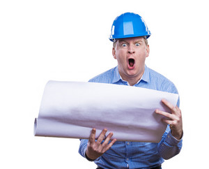 Engineer in blue hard hat holding a blueprint. Studio shot on white background.