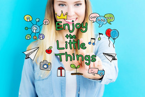 Enjoy The Little Things concept with young woman on blue background