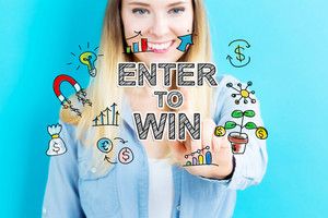 Enter to Win concept with young woman on blue background