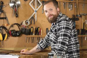 Environmental portrait of a carpenter in workshop