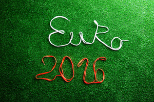 Euro 2016 sign made of shoelaces against artificial turf, studio shot on green background.