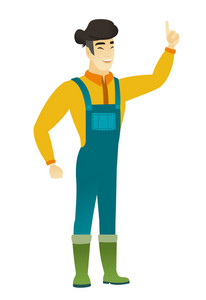 Excited farmer in coveralls pointing with his finger. Full length of asian farmer pointing his finger up. Farmer with finger pointing up. Vector flat design illustration isolated on white background.
