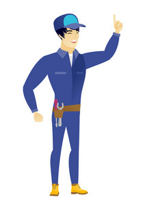 Excited mechanic pointing with his finger. Full length of mechanic pointing his finger up. Young asian mechanic with finger pointing up. Vector flat design illustration isolated on white background.