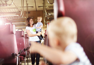 Family with two children travel in retro train.