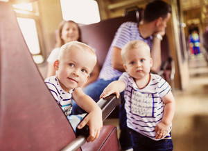 Family with two children traveling in train.