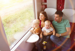 Family with two sons travel in train.