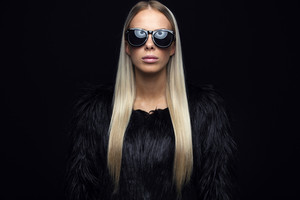 Fashion woman with hairy jacket and sunglasses