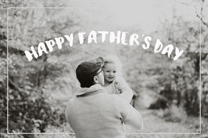 Father holding his little daughter in the arms in autumn nature. Fathers day concept.