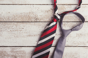 Fathers day composition of two ties laid on wooden floor background.