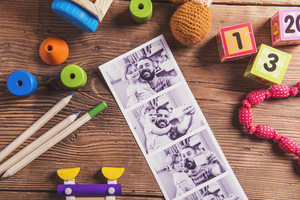 Fathers day composition - toys on floor. Studio shot on wooden background.