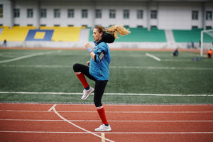 Female athlete training on stadium