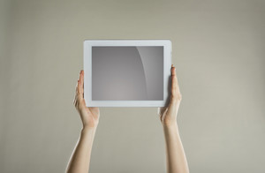 Female hands holding a tablet with isolated screen