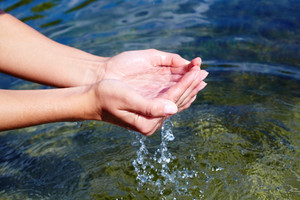 Female hands with clear fresh water