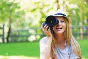 Female photographer with a DSLR camera outside