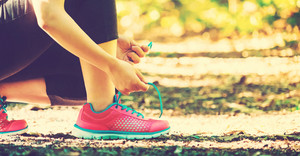 Female runner preparing to go for a jog outdoors