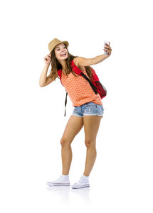 Female tourist taking selfie with cell phone isolated on white background