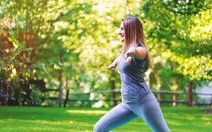 Fit healthy young woman doing stretches outdoors
