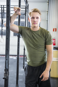 Fit Male Athlete Leaning On Metal Structure At Health Club