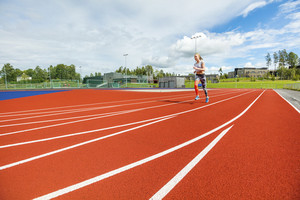 Fit Young Woman Running On Sports Tracks