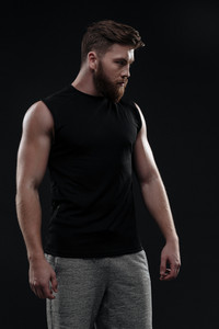 Fitness man looking away. isolated dark background