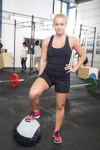 Fitness woman with medicine ball at the gym