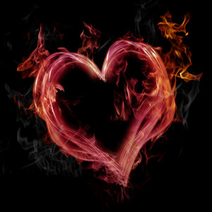 Flaming pink heart on black background