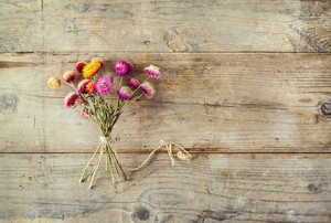 Flowers on a wooden floor background. View from above.