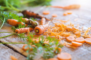 Fresh carrot laid on a wooden table