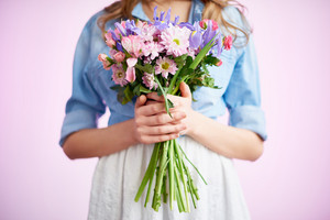 Fresh spring bouquet in hands of young female