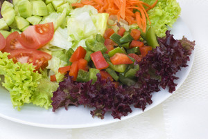Fresh vegetable salad on the desk.