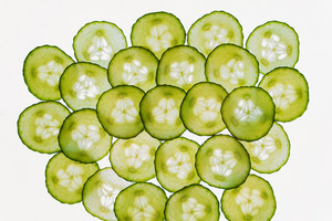 Fresh vegetables slices abstract seamless pattern background, green cucumber