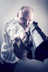 Frustrated Businessman Aiming Gun