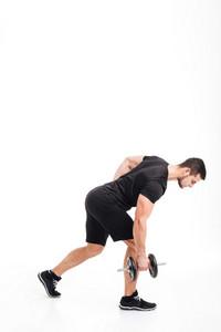 Full length bodybuilder doing exercises with dumbbell. isolated white background