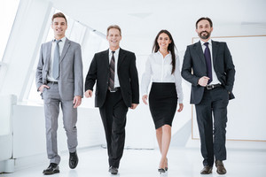 Full length Confident Business people walk in office