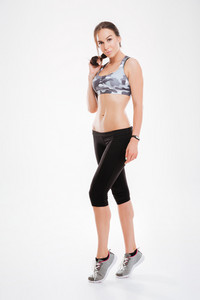 Full length fitness woman. looking at camera. isolated white background