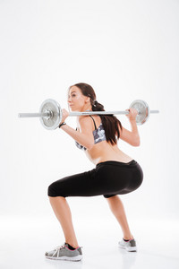 Full length image of fitness girl with barbell. back view. isolated white background