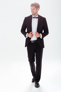 Full length model in suit. white background