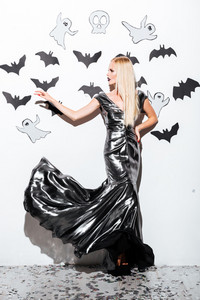 Full length of beautiful blonde young woman with halloween makeup over wite background
