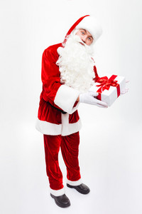 Full length of man santa claus standing and holding present box
