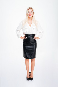 Full length of smiling beautiful young businesswoman standing over white background