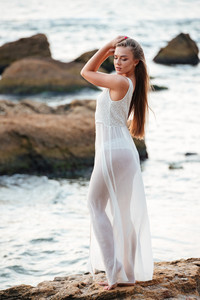 Full length pretty model on the beach. very nice