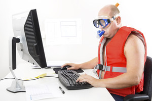 Funny businessman in diving mask and snorkel