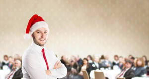 Funny businessman with christmas cap is on conference