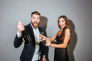 Funny couple with champagne. with stemware