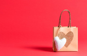 Gift bag with heart on a red background