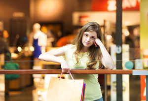Girl in the shopping centre looking tired